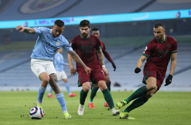 Gabriel Jesus of Manchester City controls the ball whilst under pressure from Romain Saiss and Ruben Neves of Wolverhampton Wanderers during the Premier League match between Manchester City and Wolverhampton Wanderers at Etihad Stadium on March 02, 2021 in Manchester, England. Sporting stadiums around the UK remain under strict restrictions due to the Coronavirus Pandemic as Government social distancing laws prohibit fans inside venues resulting in games being played behind closed doors. (Photo by Clive Brunskill/Getty Images)
