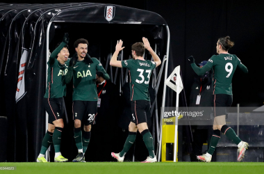 LONDON, ENGLAND - MARCH 04: Dele Alli of Tottenham Hotspur celebrates with teammates Son Heung-Min, Ben Davies, and Gareth Bale after scoring his team's first goal during the Premier League match between Fulham and Tottenham Hotspur at Craven Cottage on March 04, 2021 in London, England. Sporting stadiums around the UK remain under strict restrictions due to the Coronavirus Pandemic as Government social distancing laws prohibit fans inside venues resulting in games being played behind closed doors. (Photo by Kirsty Wigglesworth - Pool/Getty Images)