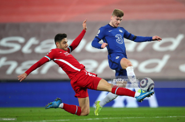 LIVERPOOL, ENGLAND - MARCH 04: Timo Werner of Chelsea is challenged by Ozan Kabak of Liverpool as he scores a goal which is disallowed following a VAR review during the Premier League match between Liverpool and Chelsea at Anfield on March 04, 2021 in Liverpool, England. Sporting stadiums around the UK remain under strict restrictions due to the Coronavirus Pandemic as Government social distancing laws prohibit fans inside venues resulting in games being played behind closed doors. (Photo by Chelsea Football Club/Chelsea FC via Getty Images)