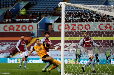BIRMINGHAM, ENGLAND - MARCH 06: Romain Saiss of Wolverhampton Wanderers misses a goal scoring opportunity during the Premier League match between Aston Villa and Wolverhampton Wanderers at Villa Park on March 06, 2021 in Birmingham, England. Sporting stadiums around the UK remain under strict restrictions due to the Coronavirus Pandemic as Government social distancing laws prohibit fans inside venues resulting in games being played behind closed doors. (Photo by Catherine Ivill/Getty Images)