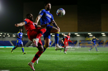 AFC Wimbledon 1-1 Wigan: Dobson's late header rescues a point for the Dons