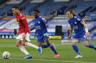 LEICESTER, ENGLAND - MARCH 21: Mason Greenwood of Manchester United in action with Wilfred Ndidi and Caglar Soyuncu of Leicester City during the FA Cup Quarter-Final match between Leicester City and Manchester United at The King Power Stadium on March 21, 2021 in Leicester, England. Sporting stadiums around the UK remain under strict restrictions due to the Coronavirus Pandemic as Government social distancing laws prohibit fans inside venues resulting in games being played behind closed doors. (Photo by Matthew Peters/Manchester United via Getty Images)