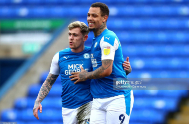 Sky Bet League One round-up: Posh hit seven, Wimbledon crucially win late on