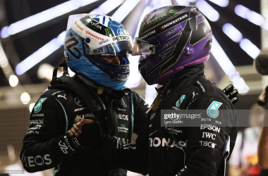 Race winner Lewis Hamilton of Great Britain and Mercedes GP shakes hands with teammate and third placed Valtteri Bottas of Finland and Mercedes GP in parc ferme after the F1 Grand Prix of Bahrain at Bahrain International Circuit on March 28, 2021 in Bahrain, Bahrain. (Photo by Lars Baron/Getty Images)