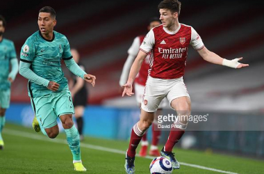 Kieran Tierney of Arsenal takes on Roberto Firmino of Liverpool during the Premier League match between Arsenal and Liverpool at Emirates Stadium on April 03, 2021 in London, England. (Photo by David Price/Arsenal FC via Getty Images)