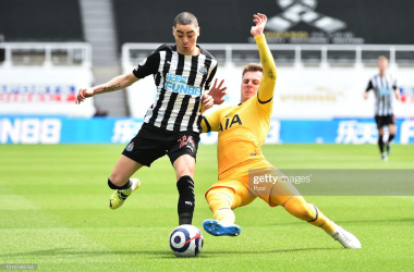 NEWCASTLE UPON TYNE, ENGLAND - APRIL 04: Miguel Almiron of Newcastle United is challenged by Joe Rodon of Tottenham Hotspur during the Premier League match between Newcastle United and Tottenham Hotspur at St. James Park on April 04, 2021 in Newcastle upon Tyne, England. Sporting stadiums around the UK remain under strict restrictions due to the Coronavirus Pandemic as Government social distancing laws prohibit fans inside venues resulting in games being played behind closed doors. (Photo by Peter Powell - Pool/Getty Images)