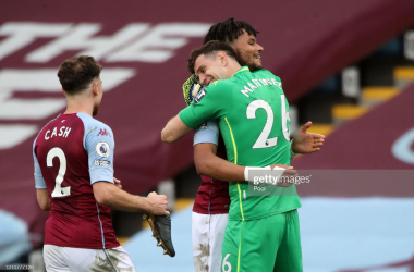 Tyrone Mings and Emiliano Martinez embracing each other via Pool- Getty Images