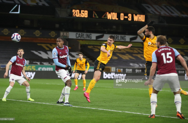 WOLVERHAMPTON, ENGLAND - APRIL 05: Leander Dendoncker of Wolverhampton Wanderers scores their team's first goal past Issa Diop of West Ham United United during the Premier League match between Wolverhampton Wanderers and West Ham United at Molineux on April 05, 2021 in Wolverhampton, England. Sporting stadiums around the UK remain under strict restrictions due to the Coronavirus Pandemic as Government social distancing laws prohibit fans inside venues resulting in games being played behind closed doors. (Photo by Nick Potts - Pool/Getty Images)