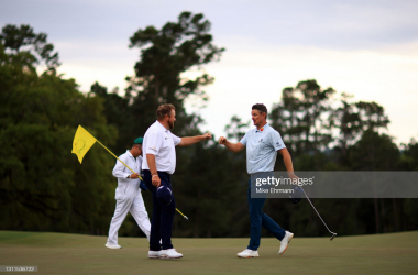 AUGUSTA, GEORGIA - APRIL 08: Justin Rose of England fist bumps Shane Lowry of Ireland on the 18th green during the first round of the Masters at Augusta National Golf Club on April 08, 2021 in Augusta, Georgia. (Photo by Mike Ehrmann/Getty Images)