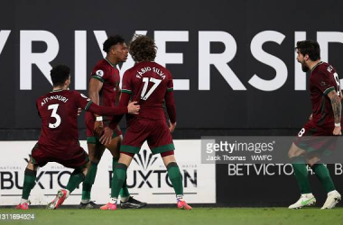 LONDON, ENGLAND - APRIL 09: Adama Traore of Wolverhampton Wanderers celebrates with Rayan Ait-Nouri, Fabio Silva and Ruben Neves after scoring their team's first goal during the Premier League match between Fulham and Wolverhampton Wanderers at Craven Cottage on April 09, 2021 in London, England. Sporting stadiums around the UK remain under strict restrictions due to the Coronavirus Pandemic as Government social distancing laws prohibit fans inside venues resulting in games being played behind closed doors. (Photo by Jack Thomas - WWFC/Wolves via Getty Images)
