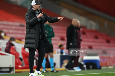 LIVERPOOL, ENGLAND - APRIL 14: Jurgen Klopp, Manager of Liverpool reacts during the UEFA Champions League Quarter Final Second Leg match between Liverpool FC and Real Madrid at Anfield on April 14, 2021 in Liverpool, England. Sporting stadiums around the UK remain under strict restrictions due to the Coronavirus Pandemic as Government social distancing laws prohibit fans inside venues resulting in games being played behind closed doors. (Photo by Shaun Botterill/Getty Images)