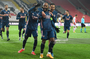 PRAGUE, CZECH REPUBLIC - APRIL 15: (2ndL) Alex Lacazette celebrates scoring the 2nd Arsenal goal with (L) Nicolas Pepe and (R) Dani Ceballos during the UEFA Europa League Quarter Final Second Leg match between Slavia Praha and Arsenal FC at Sinobo Stadium on April 15, 2021 in Prague, Czech Republic. Sporting stadiums around Europe remain under strict restrictions due to the Coronavirus Pandemic as Government social distancing laws prohibit fans inside venues resulting in games being played behind closed doors. (Photo by Stuart MacFarlane/Arsenal FC via Getty Images)