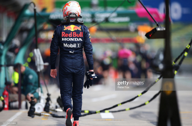 IMOLA, ITALY - APRIL 16: Max Verstappen of Netherlands and Red Bull Racing walks in the Pitlane after stopping on track during practice ahead of the F1 Grand Prix of Emilia Romagna at Autodromo Enzo e Dino Ferrari on April 16, 2021 in Imola, Italy. (Photo by Peter Fox/Getty Images)