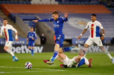 <div>LEICESTER, ENGLAND - APRIL 26: Jamie Vardy of Leicester City is tackled by Joel Ward of Crystal Palace during the Premier League match between Leicester City and Crystal Palace at The King Power Stadium on April 26, 2021 in Leicester, England. Sporting stadiums around the UK remain under strict restrictions due to the Coronavirus Pandemic as Government social distancing laws prohibit fans inside venues resulting in games being played behind closed doors. (Photo by Andrew Boyers - Pool/Getty Images)</div>
