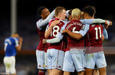 Aston Villa's Anwar El Ghazi celebrates with Ross Barkley after scoring their side's second goal during the Premier League match between Everton and Aston Villa at Goodison Park on May 01, 2021 in Liverpool, England. (Photo by Naomi Baker/Getty Images)