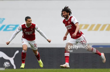 Mohamed Elneny (R) of Arsenal celebrates with team mate Gabriel Martinelli after scoring their side's first goal during the Premier League match between Newcastle United and Arsenal at St. James Park on May 02, 2021 in Newcastle upon Tyne, England. Sporting stadiums around the UK remain under strict restrictions due to the Coronavirus Pandemic as Government social distancing laws prohibit fans inside venues resulting in games being played behind closed doors. (Photo by Lee Smith - Pool/Getty Images