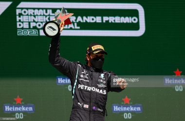 PORTIMAO, PORTUGAL - MAY 02: Race winner Lewis Hamilton of Great Britain and Mercedes GP celebrates on the podium after the F1 Grand Prix of Portugal at Autodromo Internacional Do Algarve on May 02, 2021 in Portimao, Portugal. (Photo by Bryn Lennon/Getty Images)