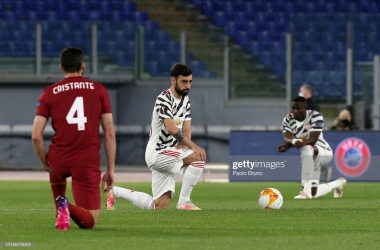 Bruno Fernandes taking the knee ahead of kick-off in Rome. Photo courtesy of Paolo Bruno/ Getty Images