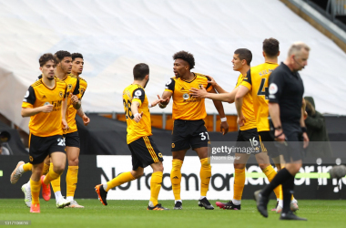 WOLVERHAMPTON, ENGLAND - MAY 09: Adama Traore of Wolverhampton Wanderers (C) celebrates after scoring their sides first goal with team mate Conor Coady during the Premier League match between Wolverhampton Wanderers and Brighton & Hove Albion at Molineux on May 09, 2021 in Wolverhampton, England. Sporting stadiums around the UK remain under strict restrictions due to the Coronavirus Pandemic as Government social distancing laws prohibit fans inside venues resulting in games being played behind closed doors. (Photo by Naomi Baker/Getty Images)