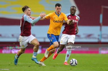 BIRMINGHAM, ENGLAND - MAY 13: Michael Keane of Everton is challenged by Jack Grealish of Aston Villa during the Premier League match between Aston Villa and Everton at Villa Park on May 13, 2021 in Birmingham, England. Sporting stadiums around England remain under strict restrictions due to the Coronavirus Pandemic as Government social distancing laws prohibit fans inside venues resulting in games being played behind closed doors. (Photo by Alex Livesey/Getty Images)