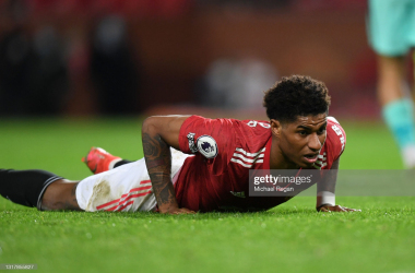 Marcus Rashford on the floor after missing a good opportunity to score a consolation goal. Photo courtesy of Michael Regan/ Getty Images