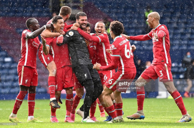 WEST BROMWICH, ENGLAND - MAY 16: Alisson of Liverpool celebrates with Roberto Firmino, Thiago and team mates after scoring their side's second goal during the Premier League match between West Bromwich Albion and Liverpool at The Hawthorns on May 16, 2021 in West Bromwich, England. Sporting stadiums around the UK remain under strict restrictions due to the Coronavirus Pandemic as Government social distancing laws prohibit fans inside venues resulting in games being played behind closed doors. (Photo by Laurence Griffiths/Getty Images)