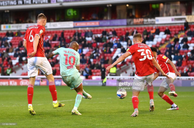 <div>Barnsley v Swansea City - Sky Bet Championship Play-off Semi Final 1st Leg</div><div>BARNSLEY, ENGLAND - MAY 17: Andre Ayew of Swansea City scores his team's first goal while under pressure from Mads Juel Andersen and Michal Helik of Barnsley FC during the Sky Bet Championship Play-off Semi Final 1st Leg match between Barnsley and Swansea City at Oakwell Stadium on May 17, 2021 in Barnsley, England. A limited number of fans will be allowed into the stadium as Coronavirus restrictions begin to ease in the UK following the COVID-19 pandemic. (Photo by Laurence Griffiths/Getty Images)</div>