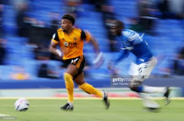 LIVERPOOL, ENGLAND - MAY 19: Adama Traore of Wolverhampton Wanderers (L) runs with the ball during the Premier League match between Everton and Wolverhampton Wanderers at Goodison Park on May 19, 2021 in Liverpool, England. A limited number of fans will be allowed into Premier League stadiums as coronavirus restrictions begin to ease in the UK. (Photo by Jack Thomas - WWFC/Wolves via Getty Images)