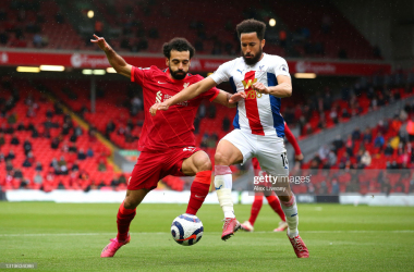 LIVERPOOL, ENGLAND - MAY 23: Mohamed Salah of Liverpool battles for possession with Andros Townsend of Crystal Palace during the Premier League match between Liverpool and Crystal Palace at Anfield on May 23, 2021 in Liverpool, England. A limited number of fans will be allowed into Premier League stadiums as Coronavirus restrictions begin to ease in the UK. (Photo by Alex Livesey/Getty Images)
