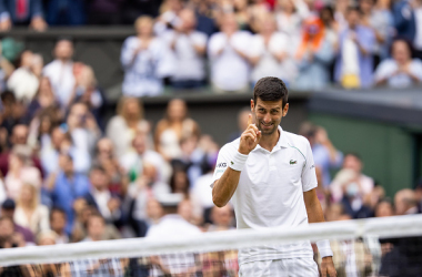 Djokovic all smiles after Wimbledon (Simon Bruty/Getty Images)