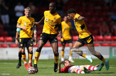 CREWE, ENGLAND - JULY 17: Willy Boly of Wolverhampton Wanderers runs with the ball away from Christopher Long of Crewe Alexandra during the Pre-Season friendly match between Crewe Alexandra and Wolverhampton Wanderers at Gresty Road on July 17, 2021 in Crewe, England. (Photo by Jack Thomas - WWFC/Wolves via Getty Images)