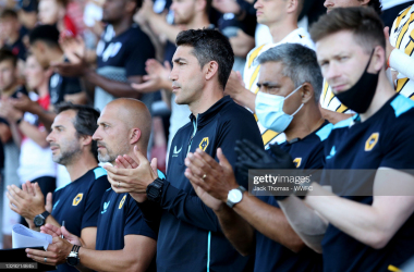 CREWE, ENGLAND - JULY 17: Bruno Lage, Manager of Wolverhampton Wanderers and his backroom staff observe a period of applause for former Crew Alexandra announcer Andrew Scoffin, who recently passed away prior to the Pre-Season friendly match between Crewe Alexandra and Wolverhampton Wanderers at Gresty Road on July 17, 2021 in Crewe, England. (Photo by Jack Thomas - WWFC/Wolves via Getty Images)