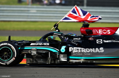 Race winner Lewis Hamilton waves the Union Jack to celebrate during the F1 Grand Prix of Great Britain at Silverstone (Photo by Joe Portlock - Formula 1/Formula 1 via Getty Images)