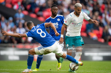 <div>LONDON, ENGLAND - AUGUST 07: Youri Tielemans of Leicester City tackles Riyad Mahrez of Manchester City during the The FA Community Shield between Manchester City and Leicester City at Wembley Stadium on August 07, 2021 in London, England. (Photo by Visionhaus/Getty Images)</div>