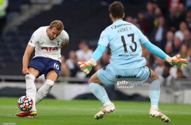 LONDON, ENGLAND - AUGUST 26: Harry Kane of Tottenham Hotspur takes a shot under pressure from Andre Ferreira of Pacos de Ferreira during the UEFA Conference League Play-Offs Leg Two match between Tottenham Hotspur and Pacos de Ferreira at on August 26, 2021 in London, England. (Photo by Catherine Ivill/Getty Images)