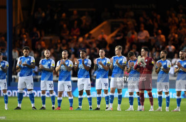 Players of Peterborough United take part in a minutes applause prior to the Sky Bet Championship match between Peterborough United and West Bromwich Albion at London Road Stadium on August 28, 2021 in Peterborough, England. (Photo by Harriet Lander/Getty Images)
