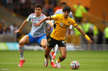 WOLVERHAMPTON, ENGLAND - AUGUST 29: Raul Jimenez of Wolverhampton Wanderers in action with Harry Maguire of Manchester United during the Premier League match between Wolverhampton Wanderers and Manchester United at Molineux on August 29, 2021 in Wolverhampton, England. (Photo by Chris Brunskill/Fantasista/Getty Images)