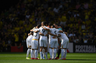 WATFORD, ENGLAND - SEPTEMBER 11: Wolverhampton Wanderers players form a team huddle prior to the Premier League match between Watford and Wolverhampton Wanderers at Vicarage Road on September 11, 2021 in Watford, England. (Photo by Harriet Lander - WWFC/Wolves via Getty Images)