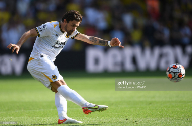 WATFORD, ENGLAND - SEPTEMBER 11: Ruben Neves of Wolverhampton Wanderers crosses the ball during the Premier League match between Watford and Wolverhampton Wanderers at Vicarage Road on September 11, 2021 in Watford, England. (Photo by Harriet Lander - WWFC/Wolves via Getty Images)