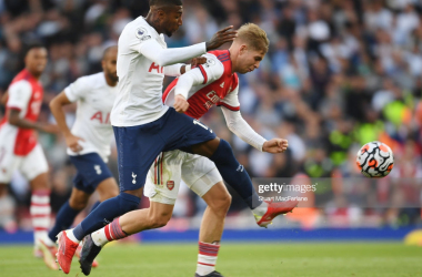 LONDON, ENGLAND - SEPTEMBER 26: Emile Smith Rowe of Arsenal takes on Emerson Royal of Tottenham during the Premier League match between Arsenal and Tottenham Hotspur at Emirates Stadium on September 26, 2021 in London, England. (Photo by Stuart MacFarlane/Arsenal FC via Getty Images)