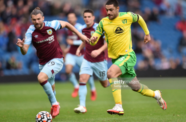 Ozan Kabak of Norwich City runs with the ball whilst under pressure from Jay Rodriguez of Burnley during the Premier League match between Burnley and Norwich City at Turf Moor on October 02, 2021 in Burnley, England. (Photo by Nathan Stirk/Getty Images)