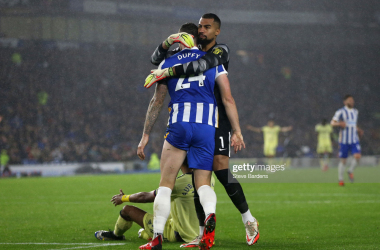 BRIGHTON, ENGLAND - OCTOBER 02: Robert Sanchez embraces Shane Duffy of Brighton & Hove Albion after he tackled Pierre-Emerick Aubameyang of Arsenal (obscured) during the Premier League match between Brighton & Hove Albion and Arsenal at American Express Community Stadium on October 02, 2021 in Brighton, England. (Photo by Steve Bardens/Getty Images)