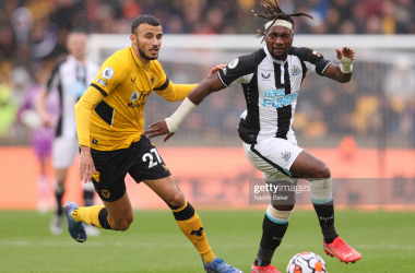 WOLVERHAMPTON, ENGLAND - OCTOBER 02: Romain Saiss of Wolverhampton Wanderers battles for possession with Allan Saint-Maximin of Newcastle United during the Premier League match between Wolverhampton Wanderers and Newcastle United at Molineux on October 02, 2021 in Wolverhampton, England. (Photo by Naomi Baker/Getty Images)