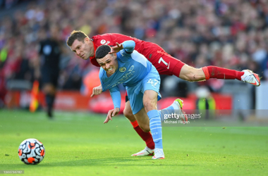 <div>LIVERPOOL, ENGLAND - OCTOBER 03: James Milner of Liverpool fouls Phil Foden of Manchester City for which he receives a yellow card during the Premier League match between Liverpool and Manchester City at Anfield on October 03, 2021 in Liverpool, England. (Photo by Michael Regan/Getty Images)</div>