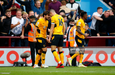 BIRMINGHAM, ENGLAND - OCTOBER 16: Conor Coady of Wolverhampton Wanderers celebrates scoring a goal with Ruben Neves (l) during the Premier League match between Aston Villa and Wolverhampton Wanderers at Villa Park on October 16, 2021 in Birmingham, England. (Photo by Malcolm Couzens/Getty Images)