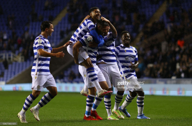 Scott Dann of Reading celebrates with teammates after scoring their side's first goal during the Sky Bet Championship match between Reading and Blackpool at Madejski Stadium on October 20, 2021 in Reading, England. (Photo by Richard Heathcote/Getty Images)