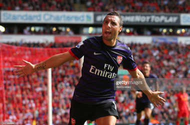 LIVERPOOL, ENGLAND - SEPTEMBER 02: Santi Cazorla of Arsenal celebrates after scoring the second goal during the Barclays Premier League match between Liverpool and Arsenal at Anfield on September 2, 2012 in Liverpool, England. (Photo by Alex Livesey/Getty Images)