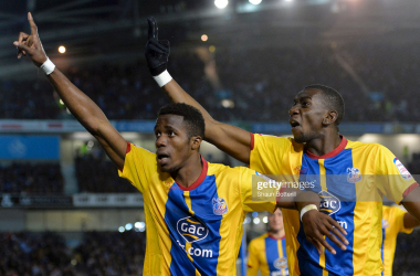 """Wilfried Zaha and Yannick Bolasie, Playoff semi-final 2013.&nbsp;<a class=""""asset-detail__link"""" data-close-and-redirect=""""true"""" data-search-type=""""photographer"""" gi-track=""""track.adp.adpContributorClicked"""" href=""""https://www.gettyimages.co.uk/search/photographer?family=editorial&photographer=Shaun+Botterill"""" rel=""""nofollow"""" style=""""box-sizing: inherit; background-color: rgb(244, 244, 244); outline: none; transition: all 0.3s ease 0s; color: rgb(111, 67, 214); font-family: Lato, sans-serif; font-size: 12px; font-style: normal; text-align: start;""""><br class=""""Apple-interchange-newline"""">Shaun Botterill</a><span class=""""asset-detail__artist-title-divider"""" style=""""box-sizing: inherit; color: rgb(8, 8, 8); font-family: Lato, sans-serif; font-size: 12px; font-style: normal; text-align: start; background-color: rgb(244, 244, 244);"""">&nbsp;/&nbsp;</span><span class=""""asset-detail__artist-title"""" style=""""box-sizing: inherit; color: rgb(8, 8, 8); font-family: Lato, sans-serif; font-size: 12px; font-style: normal; text-align: start; background-color: rgb(244, 244, 244);"""">Staff courtesy of Getty Images.</span>"""