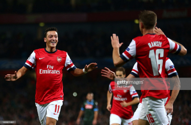 Mesut Ozil celebrates his first goal for Arsenal against Napoli in 2013 | Source: Paul Gilham / Getty