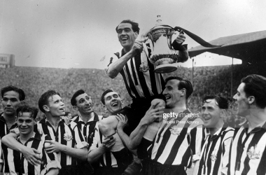 30th April 1951: Newcastle United Football Club captain Joe Harvey is held aloft with the FA Cup trophy after their 2-0 victory over Blackpool in the FA Cup final at Wembley. (Photo by Topical Press Agency/Getty Images)